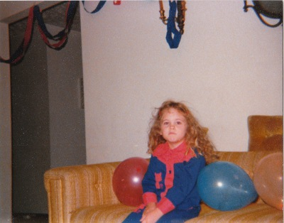 Young Shannon is not impressed, but she did dress to match her decorations.