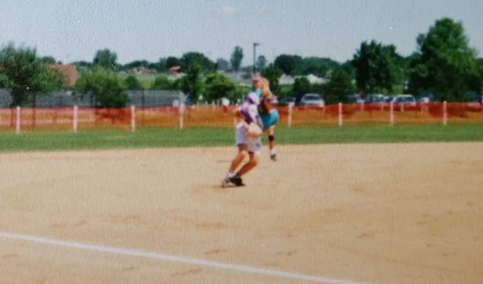 Those blurs are Heidi at shortstop and me at third. If memory serves, we called ourselves The Wall, because nothing got through our side of the infield.
