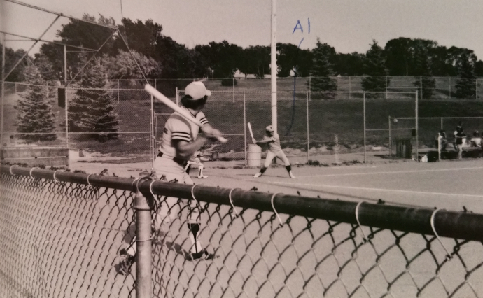 My dad at bat during a fastpitch softball game in 1979. And on the left are the pine trees any kid whose parent played softball in this town in the 70s and 80s will remember. It felt like a forest, but it turns out it was simply a few trees with dirt trails formed by our tiny feet running circles around them.